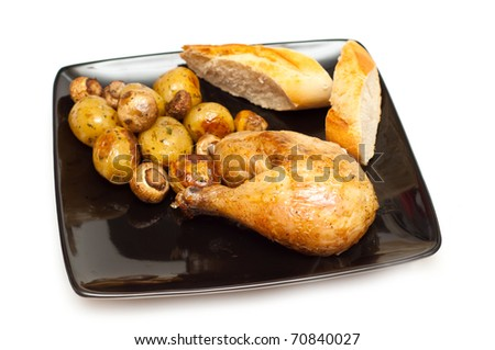 baked chicken, bread and potatoes with mushrooms