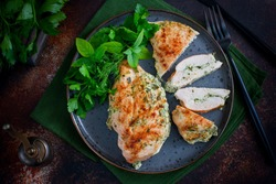 Baked chicken breast stuffed with cheese and spinach, horizontal