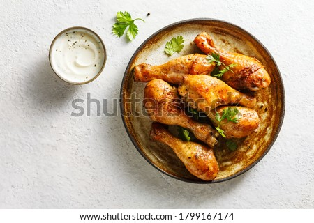 Baked chicken legs with spices and fresh herbs. Top view. Photo stock ©