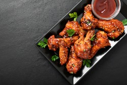 Baked chicken wings with sesame and sauce. Traditional asian recipe.
