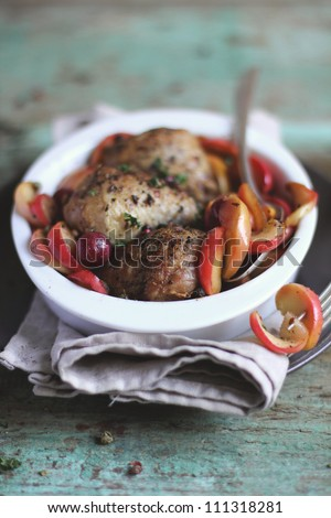 Baked chicken with autumn apples and grape from the garden in a baking dish - stock photo