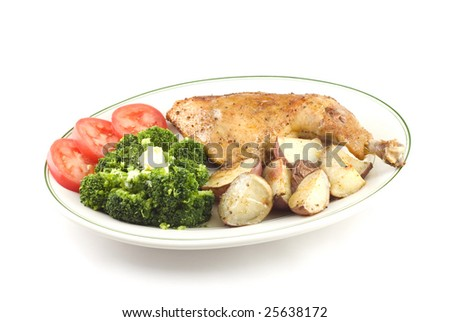 Baked chicken with steamed broccoli  and roasted red skinned potatoes isolated on white background copy space