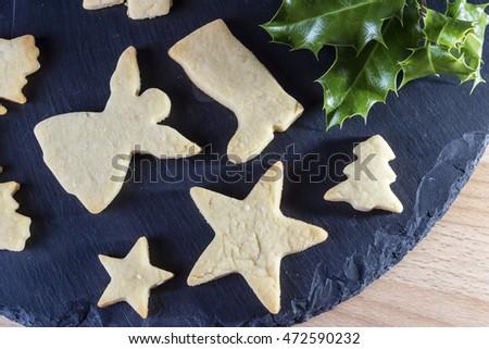 Baked Christmas shaped cookies on a slate platter #472590232