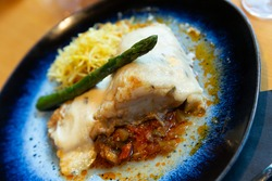 Baked cod fillet on vegetable ratatouille with chorizo, crisp shoestring fries, asparagus and rosemary aioli