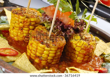 Baked corn with salsa and tortilla chips