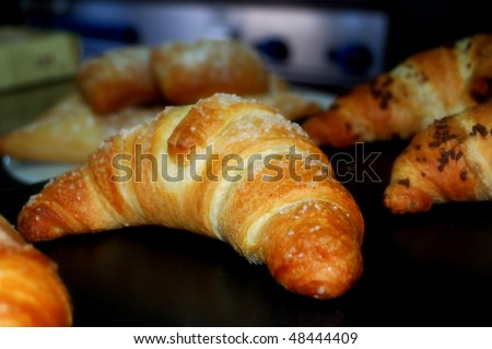 Baked croissants in a black tray