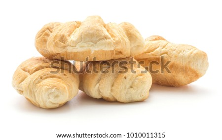 Baked croissants or cornetto set isolated on white background four whole and fresh