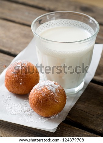 Baked doughnuts with glass of milk, selective focus