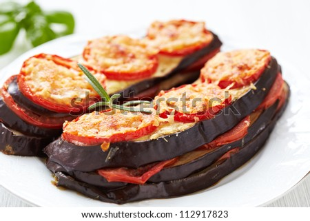 Baked eggplant with parmesan cheese, tomatoes and basil