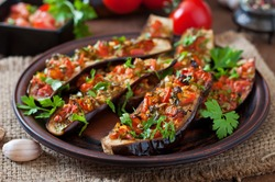 Baked eggplant with tomatoes, garlic and paprika