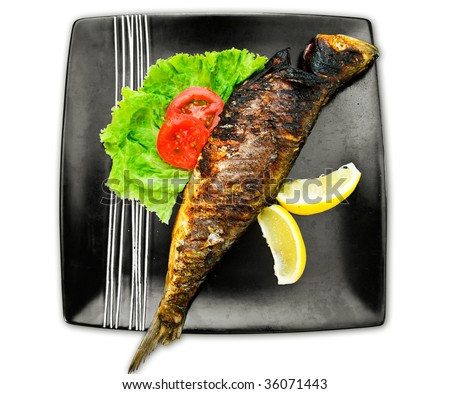 Baked fish in black plate isolated on white
