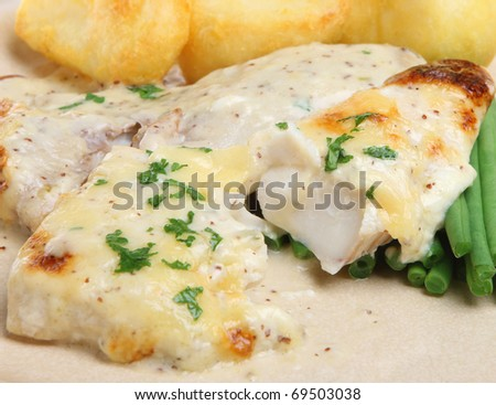 Baked fish with cheese sauce, green beans and roast potatoes.