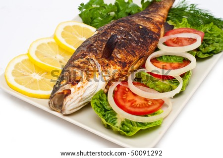 Baked fresh water sea bass isolated on white - stock photo