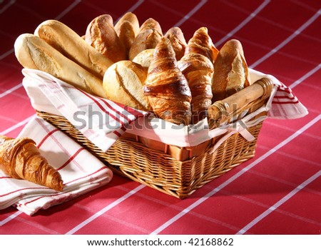 Baked goods in the basket on red tablecloth