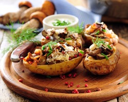 Baked halves of potato stuffed with forest wild mushrooms.