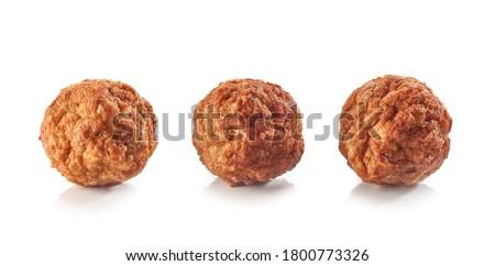 baked homemade meatballs isolated on white background