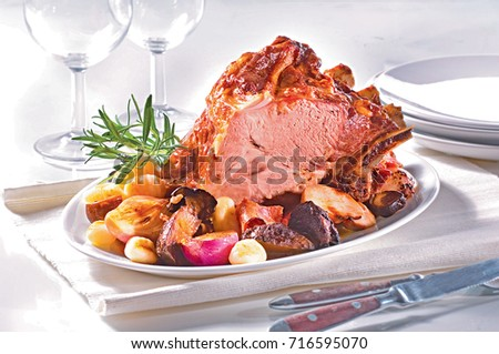 Baked meat with rosemary onion and allspice on the table #716595070