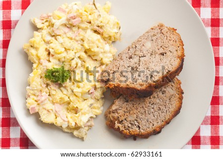 baked meatloaf with potato salad - stock photo