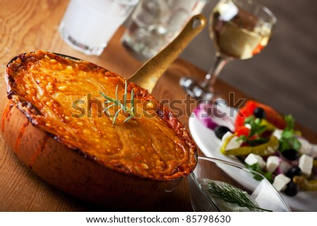 baked moussaka dish on a wooden board