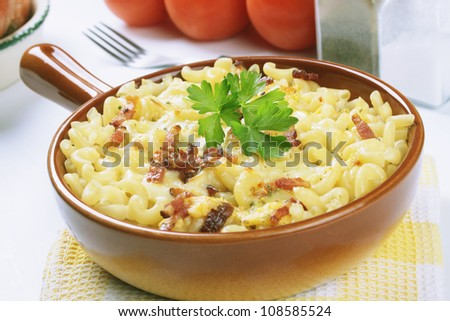 Baked pasta carbonara with bacon, eggs and cheese