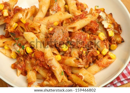Baked penne pasta with tuna fish and cheese.