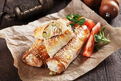 Baked phyllo pastry rolls filled with cheese and vegetables