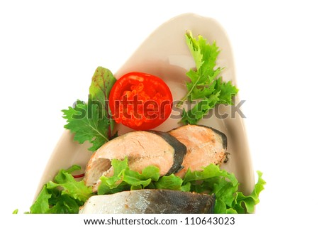 baked pink salmon served on plate with salad