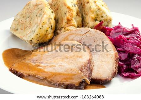 Baked pork chop with dumplings and sauerkraut