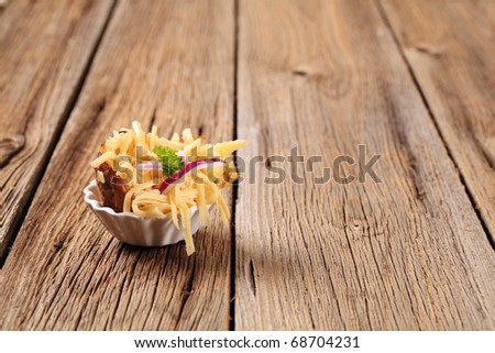 Baked potato and grated cheese