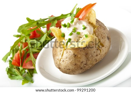 Baked potato filled with sour cream and arugula