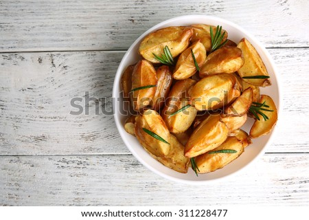 Baked potato wedges on wooden table, top view Stock photo ©