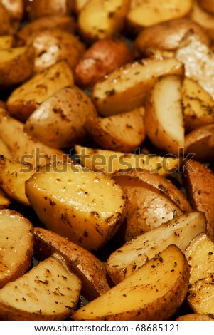 Baked Potato Wedges Seasoned With Salt, Oil And Spices Stock Photo ...