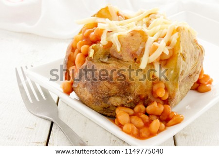 baked potato with baked beans #1149775040