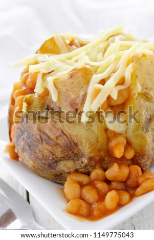 baked potato with baked beans #1149775043