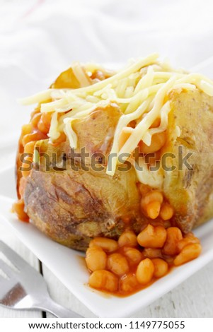 baked potato with baked beans #1149775055