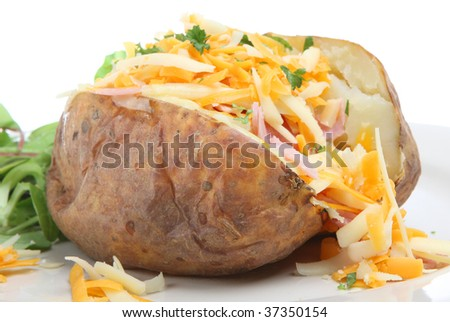 Baked potato with ham and grated cheeses