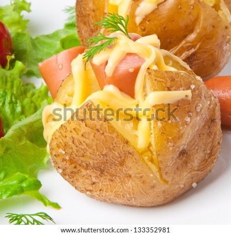 baked potato with sausages and salad