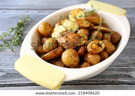 Baked potatoes in a bowl, food close-up