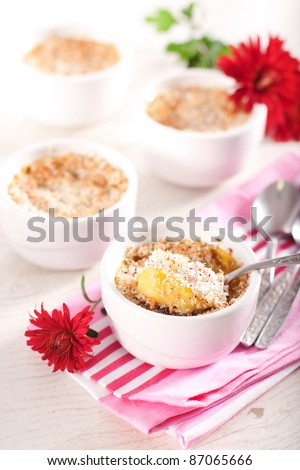 Baked pumpkin and coconut souffle in white bowls