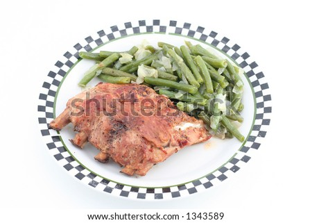 baked ribs with green beans on a plate