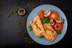 Baked salmon fish fillet with tomatoes, mushrooms and spices. Diet menu. Top view. Flat lay
