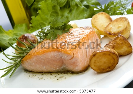 baked salmon steak with potato and rosemary