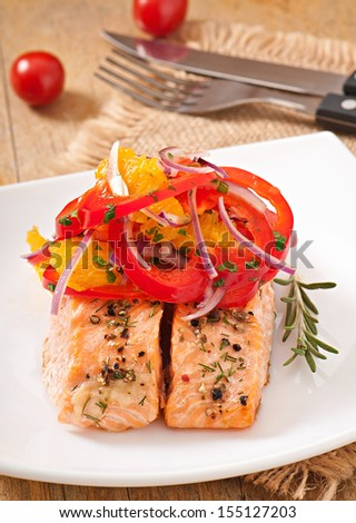 Baked salmon with a salad of sweet peppers and oranges