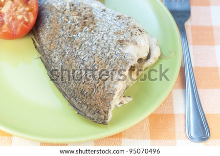 Baked seabass and tomato