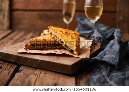 Baked spinach and ham sandwich with sauce. Photo stock ©