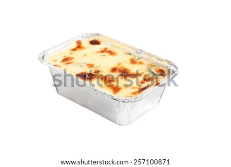 baked spinach with cheese in silver package isolated on white background