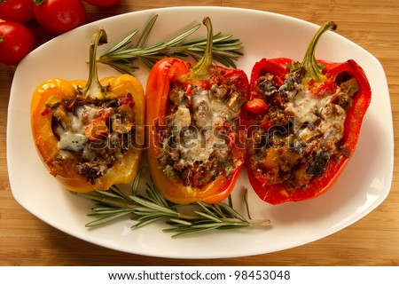 Baked stuffed red bell pepper filled with minced meat, onion, rice ...