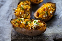 Baked sweet potato with feta cheese and chives