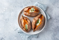 baked sweet potato with yogurt sause. Top view.