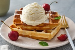 Baked traditional Belgium waffles with ice cream and cherries. Breakfast.